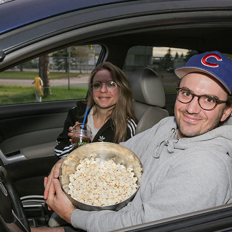 Cuties in cars at a Calgary Underground Film Festival drive-in screening